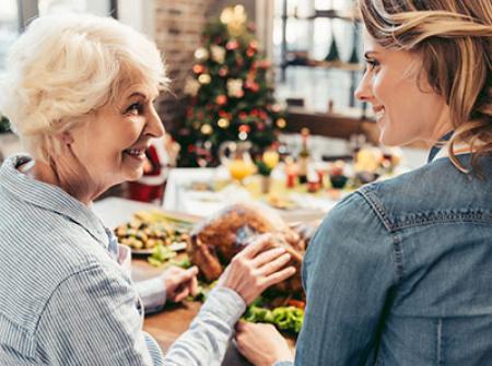 Senior celebrating the holidays with adult child