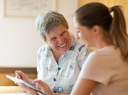 Caregiver assisting a senior with daily activities