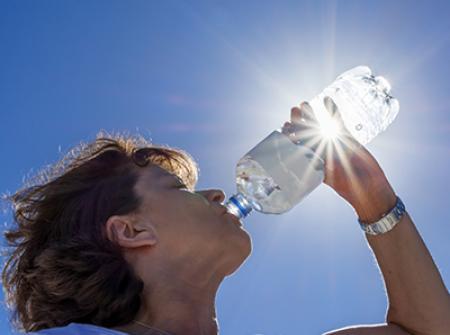 Summer drinking water in the summer sun