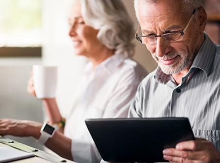 Senior couple using technology