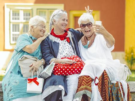 Senior laughing with group of friends